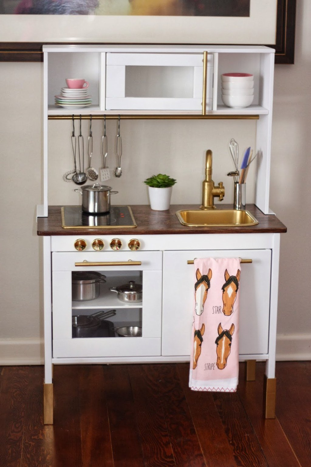 11 Or give the Ikea play kitchen a modern makeover via simphome
