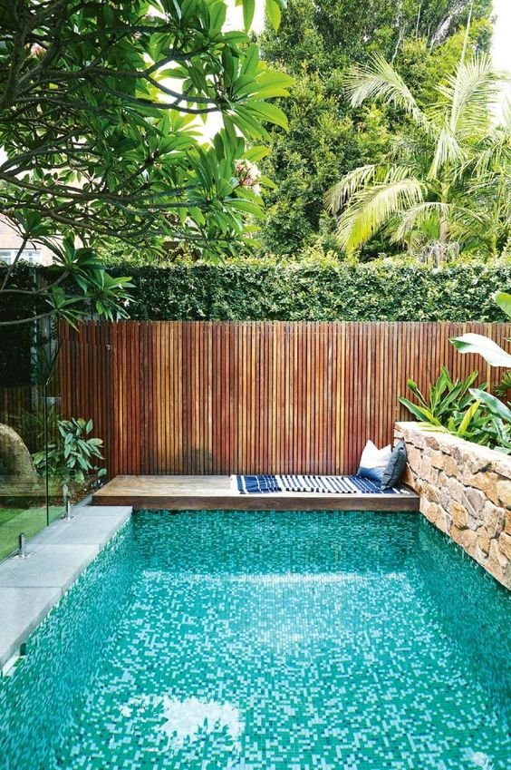 5.Above Ground Pool in Small Backyard with wooden fence via Simphome.com