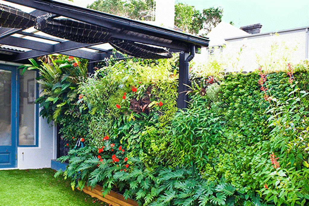 7.SIMPHOME.COM 10 Ideas how to make backyard privacy landscaping Add Variety with a Vertical Garden Bed