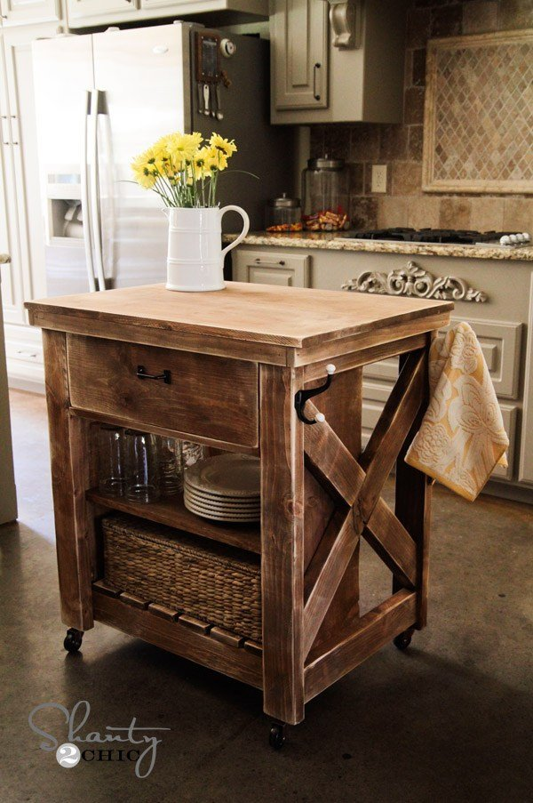 9. SIMPHOME.COM Rustic Kitchen Island with Casters and Storage Space