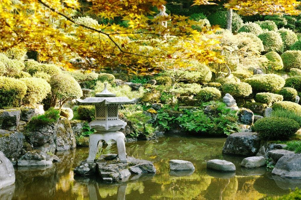 1.Round out It with a Stone Lantern via Simphome.com With Pond