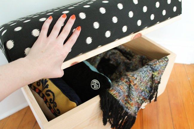 2.Try a wooden Ottoman with Storage via Simphome.com