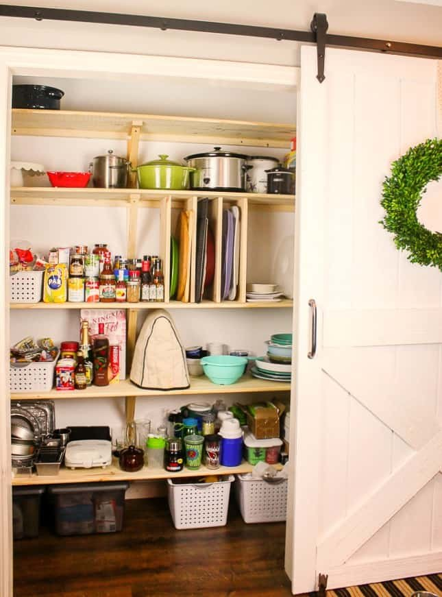 1. And for you starter this is how to build your first DIY Pantry from scratch complete with a barn door by simphome.com