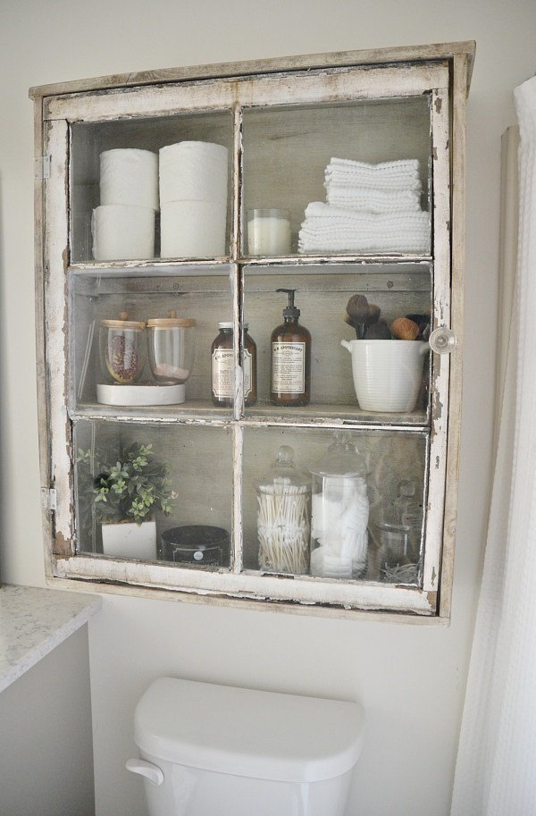 8. Complete your bathroom counter with this rustic DIY bathroom cabinet project by simphome.com