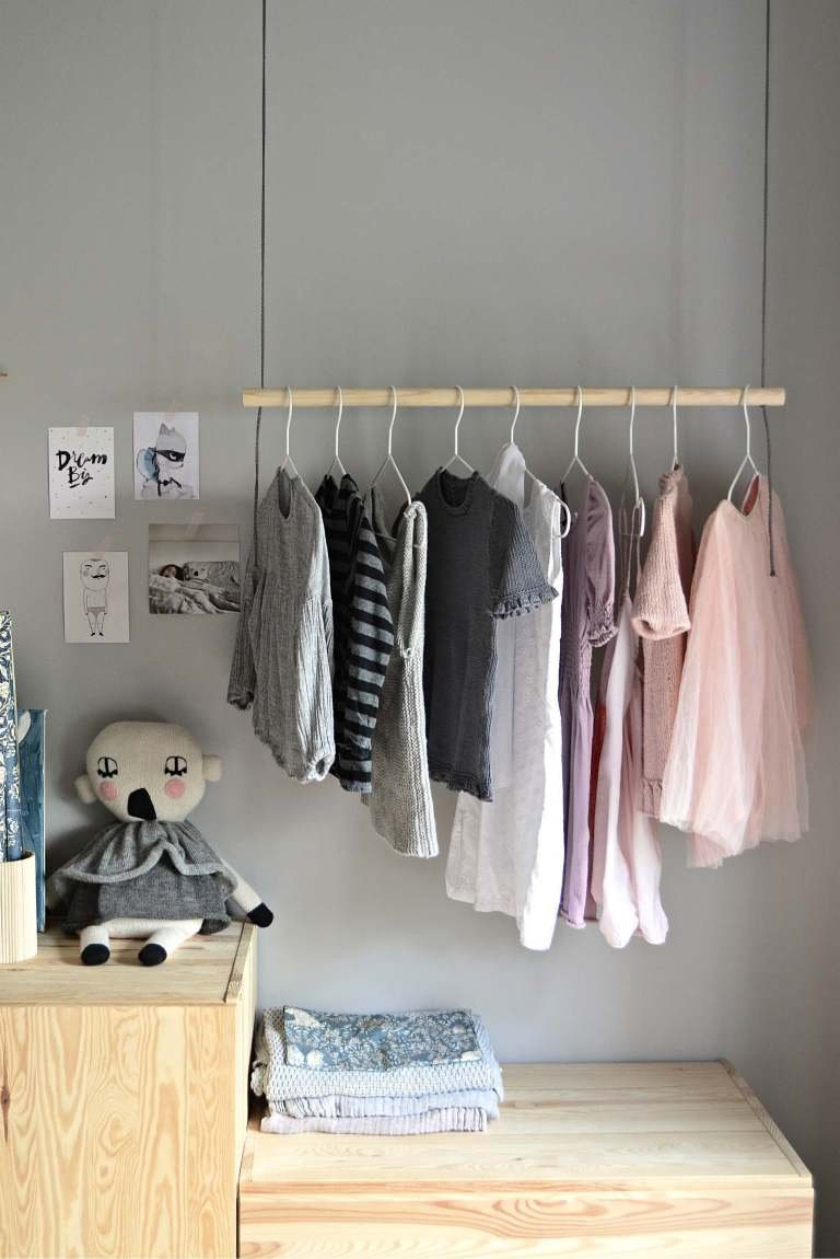 9. Hang On With This DIY Hanging Clothes Rack by simphome.com