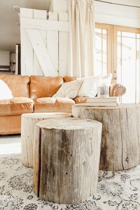 3. Go Rustic with Tree Stump Coffee Table by simphome.com