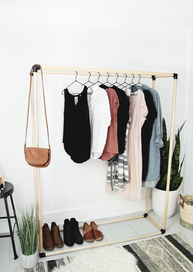 11. How to turn wooden dowels to an awesome open clothing rack easily by simphome.com .