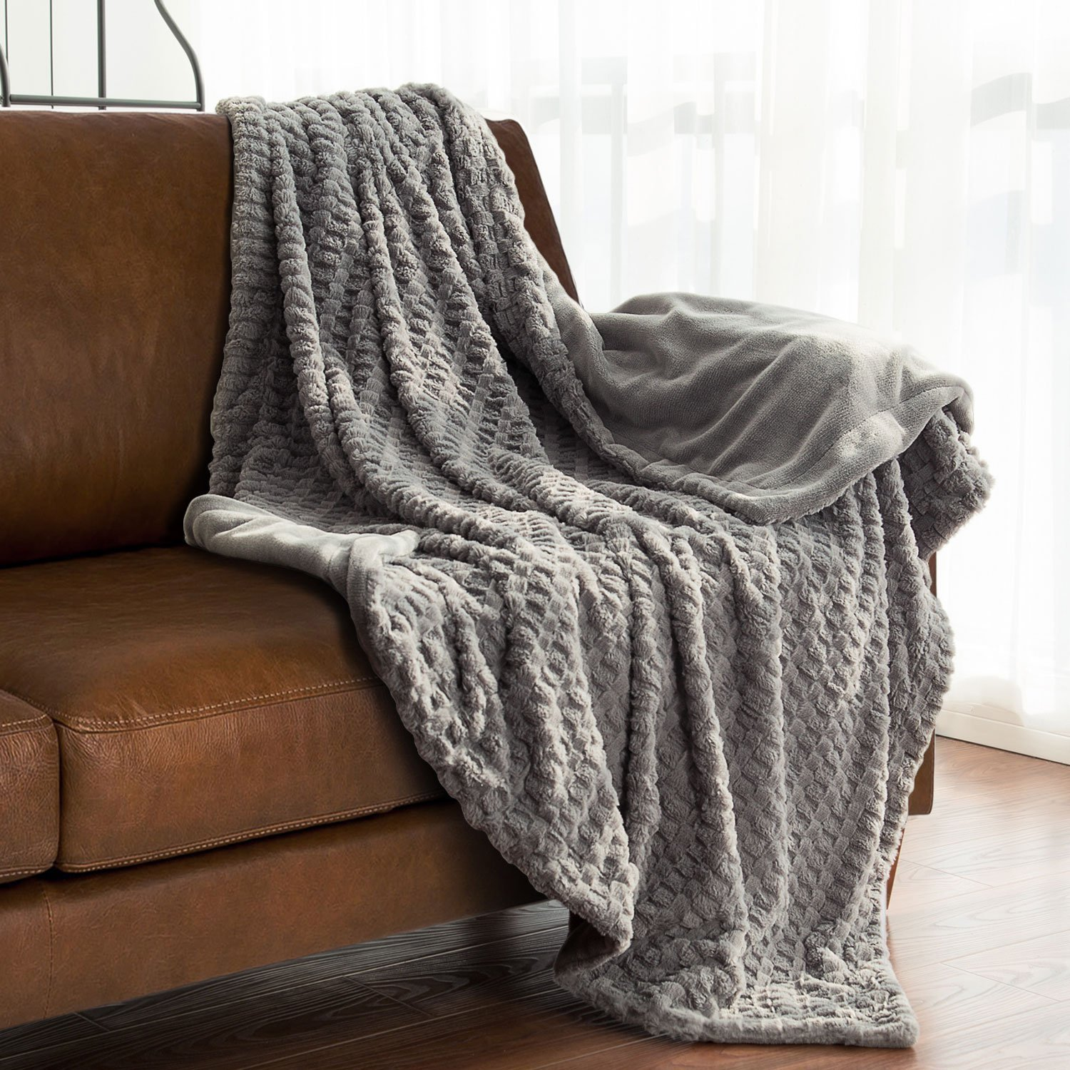 2. Simply Cover Your Couch with Throw via Simphome.com